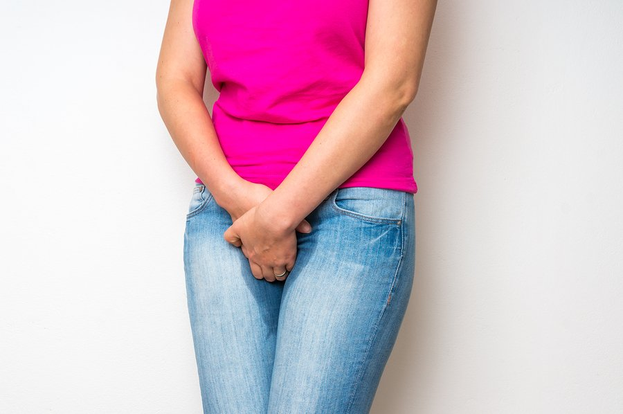 women holding her bladder looking to improve bladder control
